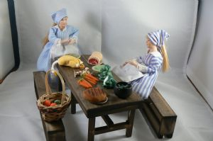 tudor table with food and kitchen maids